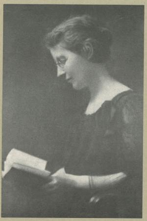 Black and white photo of Anna head reading a book.
