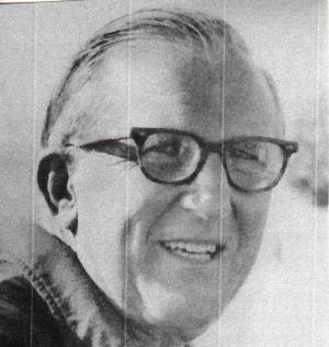 Black and white photo of Gardie Bridge, wearing glasses and smiling