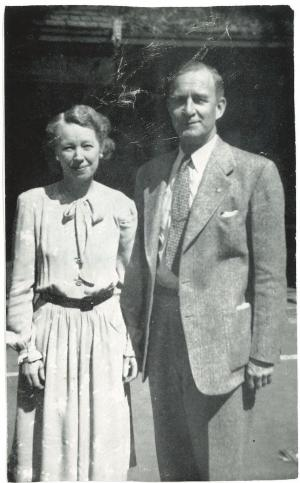 Black and white photo of Lea Hodge Hyde standing to the right of Theopholis Rogers